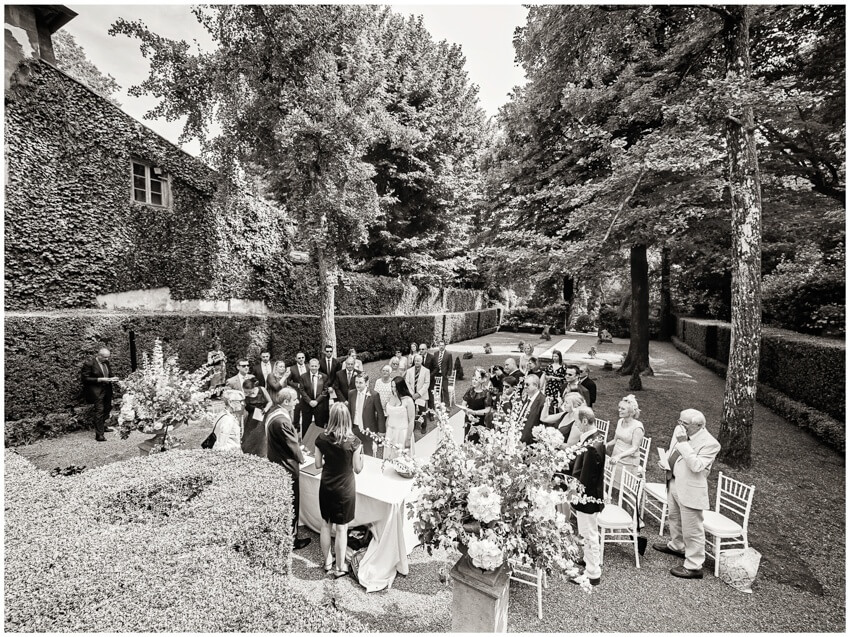 a ceremony in the garden of villa grabau